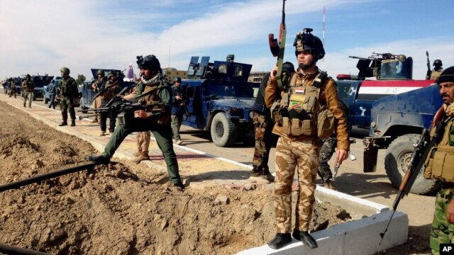 FILE - Iraqi Security forces preparing to attack al-Qaida positions in Ramadi, 70 miles (115 kilometers) west of Baghdad, Iraq.  Militants, many from the al-Qaida-breakaway group Islamic State in Iraq and the Levant, overran Fallujah and parts of Anbar's capital, Ramadi.