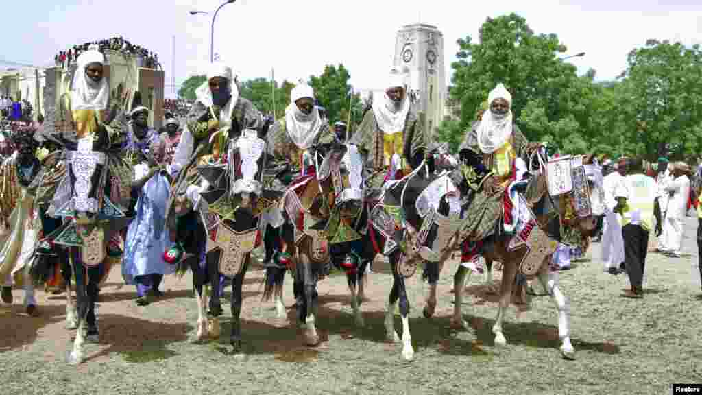 Horsemen pay homage to Emir of Kano Alhaji Ado Bayero during an event marking his 50th year on the throne.