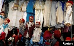 FILE - Dolls dressed in the traditional clothes are displayed at a clothing store at the Medina of Tunis, Tunisia, September 25, 2018. (REUTERS/Zoubeir Souissi)