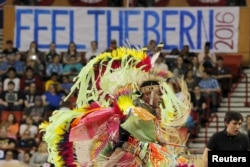 FILE - A group of Native American pow-wow dancers perform before a campaign rally with U.S. Democratic presidential candidate Bernie Sanders in Oklahoma City, Oklahoma, Feb. 28, 2016.