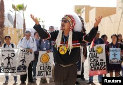 Representatives of different indigenous groups from various countries protest during the UN Climate Change Conference 2016 (COP22) in Marrakech, Morocco, Nov. 17, 2016.