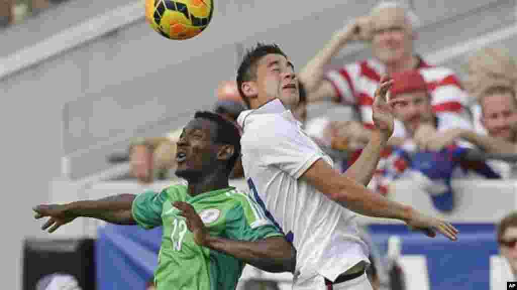 Nigeria's GoDrey Oboabona and United States's Alejandro Bedoya.