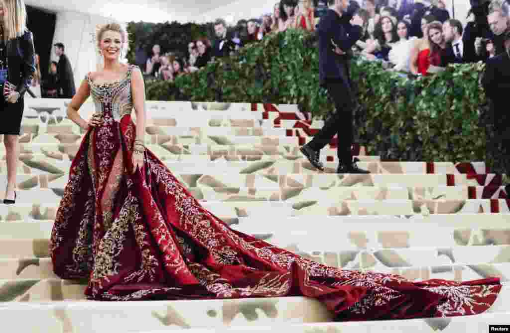 "Actor Blake Lively arrives at the Metropolitan Museum of Art Costume Institute Gala (Met Gala) to celebrate the opening of ""Heavenly Bodies: Fashion and the Catholic Imagination"" in the Manhattan borough of New York, May 7, 2018."