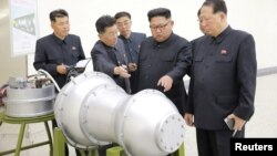 FILE - North Korean leader Kim Jong Un, center, provides guidance on a nuclear weapons program in this undated photo released by North Korea's Korean Central News Agency (KCNA) in Pyongyang, Sept. 3, 2017. KCNA via REUTERS