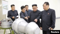 FILE - North Korean leader Kim Jong Un, center, provides guidance on a nuclear weapons program in this undated photo released by North Korea's Korean Central News Agency (KCNA) in Pyongyang, Sept. 3, 2017.
