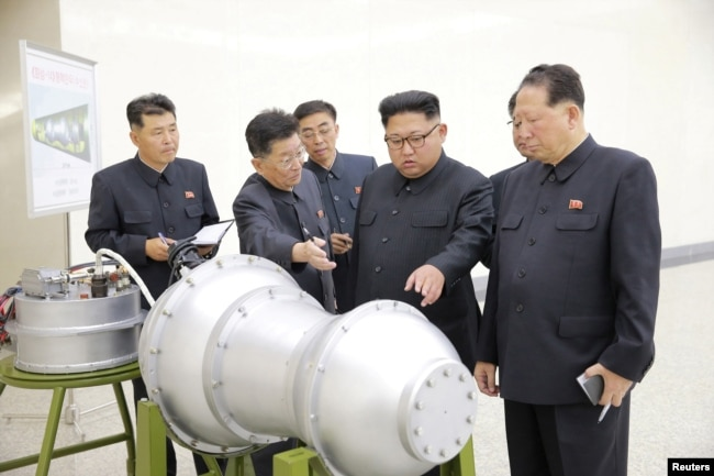 North Korean leader Kim Jong Un, center, provides guidance on a nuclear weapons program in this undated photo released by North Korea's Korean Central News Agency (KCNA) in Pyongyang, Sept. 3, 2017.