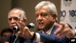 FILE - Mexico's President-elect Andres Manuel Lopez Obrador gives a press conference in Mexico City, July 9, 2018. Lopez Obrador said he and U.S. President Donald Trump spoke Wednesday about ways to ease the migrant crisis.