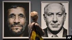지난 19일 독일에서 열린 한 전시회에 나란히 걸린 마무드 아마디네자드 이란 대통령(왼쪽)과 베냐민 네타냐후 이스라엘 총리의 초상화. (자료 사진)
