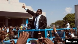 Malawi celebrates its independence anniversary with speeches, parades, football, prayers and a new president, Peter Mutharika, who waved to crowds during his inauguration a month ago.