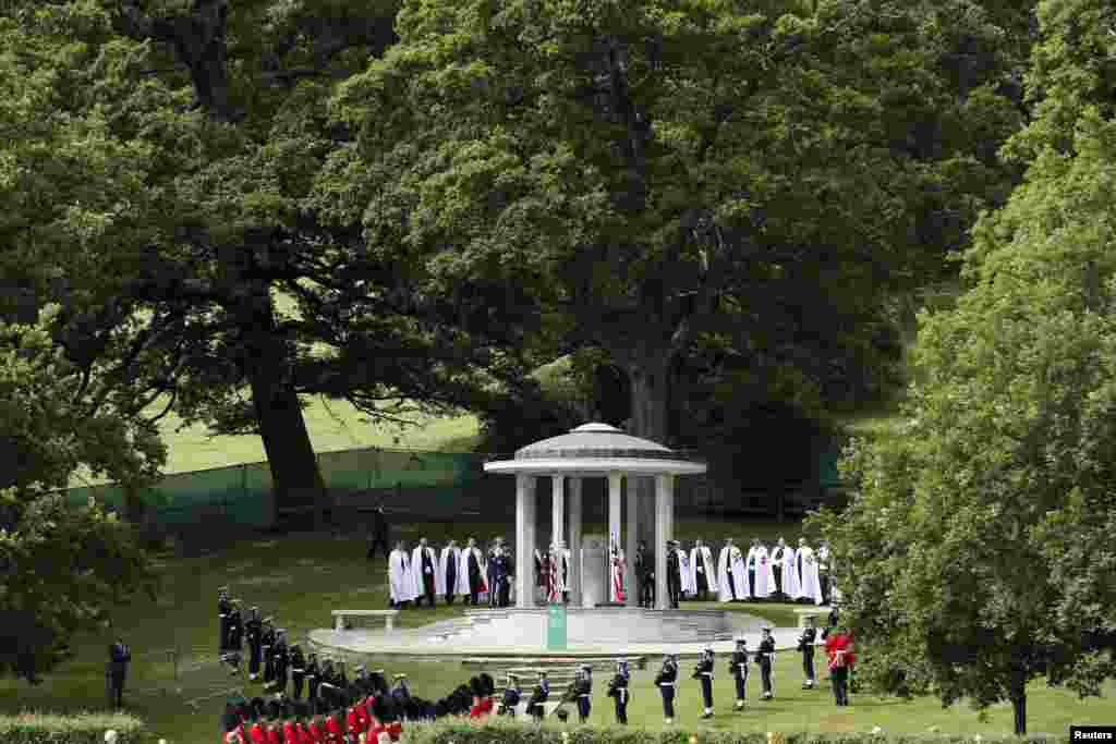Soldiers stand next to a Magna Carta memorial during an event marking the 800th anniversary of Magna Carta in Runymede, Britain.