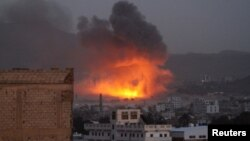Smoke billows from a fire at a Houthi-controlled military site after it was hit by a Saudi-led airstrike in San'aa, Yemen, June 3, 2015.