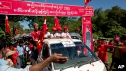 FILE - Supporters of Myanmar political leader Aung San Suu Kyi's National League for Democracy party follow her vehicle at a campaign rally in western Rakhine state, Myanmar, Oct. 17, 2015.