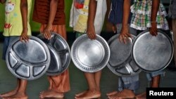 Children holding plates wait in a queue to receive food at an orphanage in the southern Indian city of Chennai. (File)