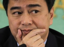 FILE - Former Thai PM Abhisit Vejjajiva attends a news conference at the Japan National Press Club in Tokyo, March 2, 2012.
