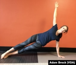 This is the advanced Side Plank pose. It improves your balance and stability.