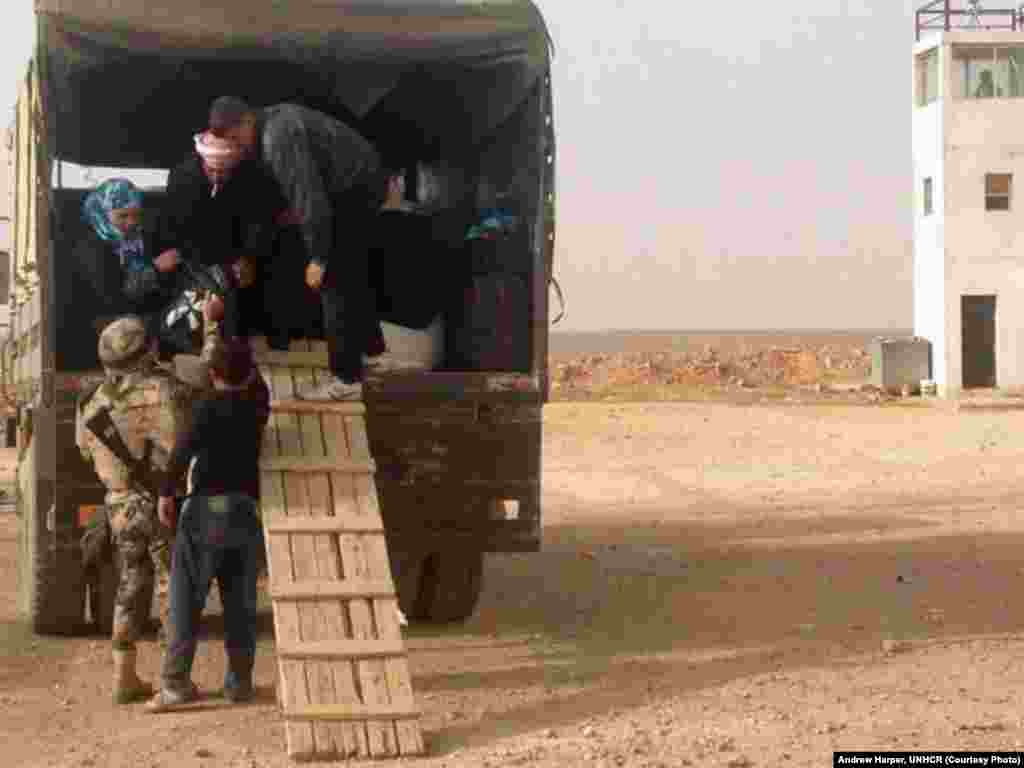 Syrian refugees in eastern Jordan's desert walking the plank into safety.