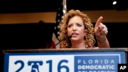 DNC Chairwoman Debbie Wasserman Schultz, D-Fla., has to speak over protesting Bernie Sanders supporters during the first day of the Democratic National Convention last month. She resigned her party position after hacked emails showed the party organization backing Hillary Clinton over Sanders for the Democratic nomination. It was supposed to be neutral. (AP Photo/Matt Slocum)