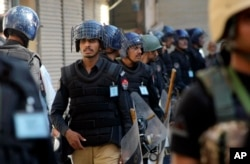 FILE - Pakistani police officers in Peshawar, Pakistan, Oct. 22, 2015.
