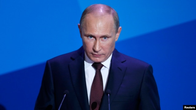 Russian President Vladimir Putin speaks during a meeting with 'Valdai' International Discussion Club members in the town of Valdai, Sept. 19, 2013.