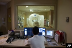 This 2015 file photo shows a PET scan being done on a patient at a hospital in Washington, D.C.