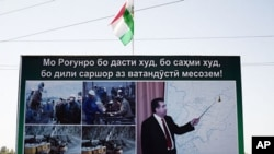 A propaganda poster for the Rogun dam project outside of Dushanbe features Tajikistan's president and builder in chief Emomalii Rahmon, October 1, 2011.