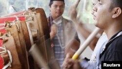 Malaysians of the Mandailing ethnic group perform Gordang Sambilan or Nine Great Drums, near Kuala Lumpur, June 27, 2012.
