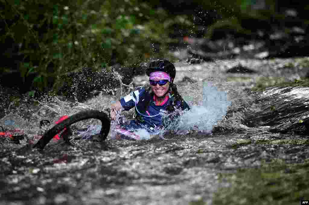 "A woman competes in the mountain bike race as part of the ""Raid des Alizes"", an exclusively all-female multi-sport competition on the French Caribbean island of Martinique."