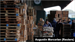 Eduardo David Rodriguez, 40, pushes a cart with bags of potatoes at the Mercado Central where he works twice a week earning 12,000 Argentine Pesos ($60) a month, in Buenos Aires, Argentina September 28, 2021.