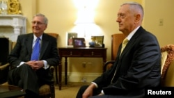 U.S. Senate Majority Leader Mitch McConnell, R-Ky., (left) welcomes retired U.S. Marine Corps General James Mattis, President-elect Donald Trump's nominee to be Defense Secretary, in his office at the Capitol in Washington, Dec. 7, 2016.