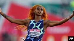 FILE - Sha'Carri Richardson celebrates after winning the fourth heat during the women's 100-meter run at Olympic trials, in Eugene, Oregon, June 18, 2021. Richardson has been disqualified from the Tokyo Olympics over the use of marijuana.