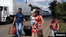 Ruski konvoj sa humanitarnom pomoći za Ukrajinu nadomak pograničnog prelaza u regionu Rostova, 21. avgusta 2014.