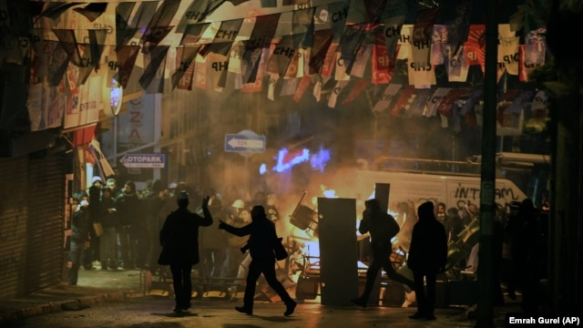 Demonstrators clash with riot police following the funeral of Berkin Elvan, who had been in a coma after a police tear-gas canister struck him in the head last year,  in Istanbul, March 12, 2014.