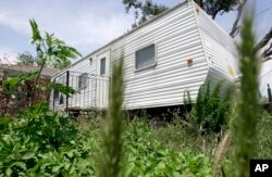 FILE - A Federal Emergency Management Agency trailer sits in front of home in the Lakeview area of New Orleans, Louisiana, May 7, 2008.
