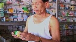 A Cambodian man purchases malaria medicine