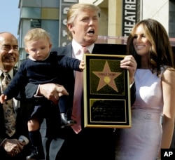 "Donald Trump, the billionaire developer, and producer of NBC's ""The Apprentice,"" with his wife, Melania Knauss, and their son, Barron, pose for a photo after he was honored with a star on the Hollywood Walk of Fame in Los Angeles, Tuesday, Jan. 16, 2007."