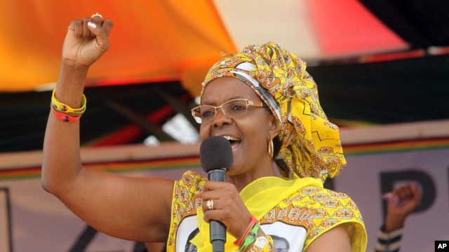 FILE - Zimbabwe's First Lady Grace Mugabe addresses party supporters at a rally in Harare, Nov. 19, 2015.