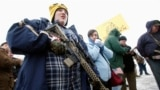 FILE - Chris Harris carries an AR-15 rifle at a pro-gun activist rally as part of the National Day of Resistance, at the state Capitol in Salt Lake City, Utah, February 23, 2013. (REUTERS/Jim Urquhart)