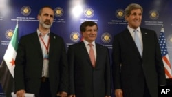 "U.S. Secretary of State John Kerry, right, Turkish Foreign Minister Ahmet Davutoglu, center, and Syrian opposition leader Moaz al-Khatib pose for photos after a ""Friends of Syria"" group meeting at the Adile Sultan Palace, April 21, 2013, in Istanbul, Turk"