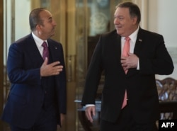 U.S. Secretary of State Mike Pompeo, right, meets with Turkish Foreign Minister Mevlut Cavusoglu at the U.S. Department of State in Washington, April 3, 2019.