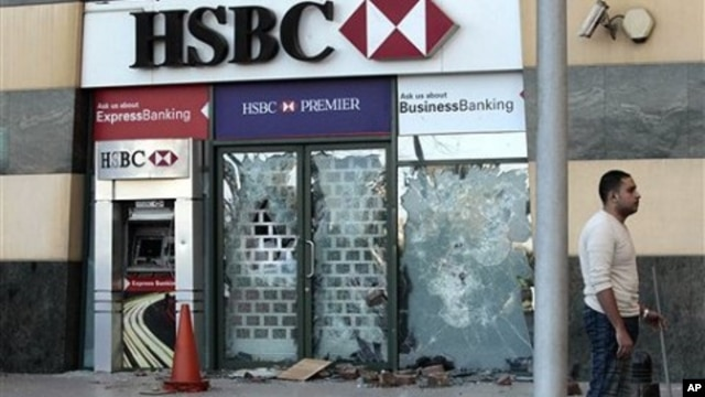A HSBC bank branch remains damaged on the Arcadia shopping center, that was looted, damaged and set on fire by people in Cairo, Egypt, January 30, 2011.