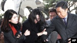 Cho Hyun-ah, center, former vice president of Korean Air Lines, arrives at the Seoul Western District Prosecutors Office in Seoul, South Korea, Dec. 30, 2014.
