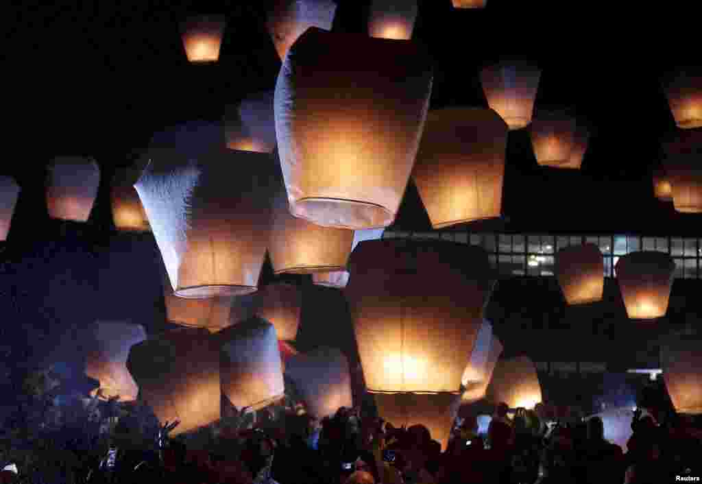 People release sky lanterns ahead of the traditional Chinese Lantern Festival in Pingxi, New Taipei City, Taiwan.