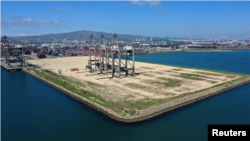 In this file photo, an empty shipping dock is seen, as the global outbreak of the coronavirus disease (COVID-19) continues, at the Port of Los Angeles, California, U.S., April 16, 2020. (REUTERS/Lucy Nicholson)