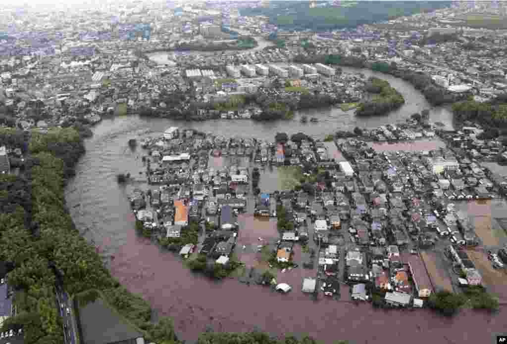 Residential streets are submerged after a river overflowed its banks in Kumamoto, Kumamoto prefecture on Japan's southern island of Kyushu.