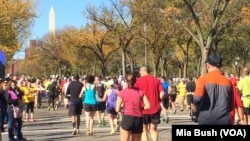 FILE - Runners head west on Independence Avenue in Washington as they near the 19-mile mark of the Marine Corps Marathon in October 2014. The Washington Monument can be seen in the distance.