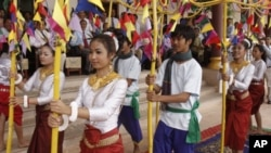 Cambodian dancers perform during a merit making ceremony Tuesday, April 12, 2011, at Cambodia's Ministry of Information in Phnom Penh, Cambodia. The ceremony was held in advance of Cambodian New Year's celebration which lasts for three days, from April 14