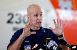 Captain Mark Fedor, a U.S. Coast Guard spokesman, says it was painful to call off the search for El Faro and the 33 people who were aboard. He's shown at an airport in Opa-locka, Fla., Oct. 5, 2015.