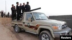 Ribuan pasukan Peshmerga Kurdi dikerahkan di Kirkuk yang disengketakan hari Jumat (13/10).