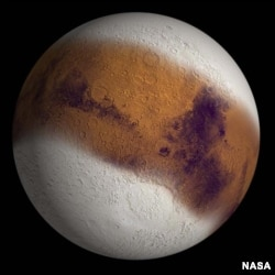 Mars with expanded polar caps (Image: NASA).