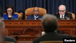 Committee Chairman U.S. Rep. John Lewis (D-GA), flanked by Rep. Suzan DelBene (D-WA) and ranking member Mike Kelly (R-PA), presides over a hearing on whether to compel candidates for U.S. president and vice president to release their tax records, in Washington, Feb. 7, 2019.